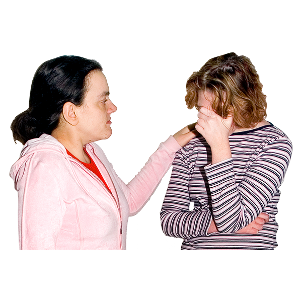 A woman supporting an upset person